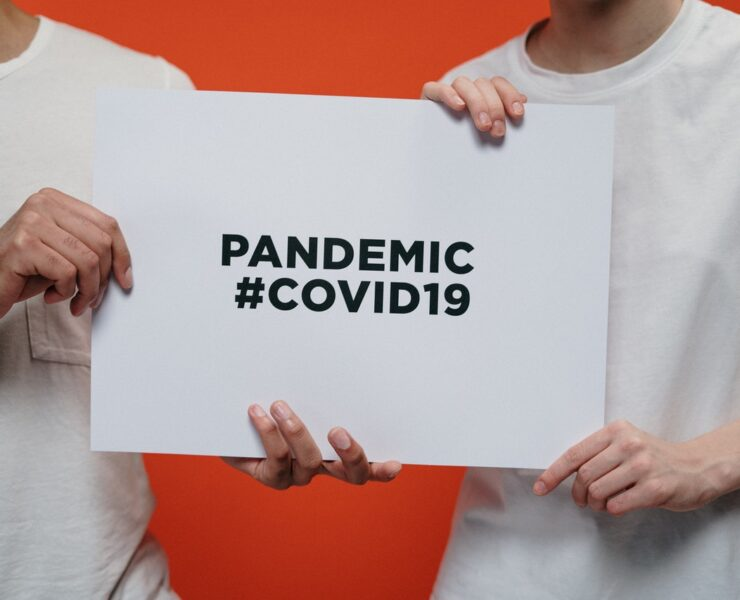 people-holding-white-paper-with-pandemic-covid19-text-asfalistikomarketing