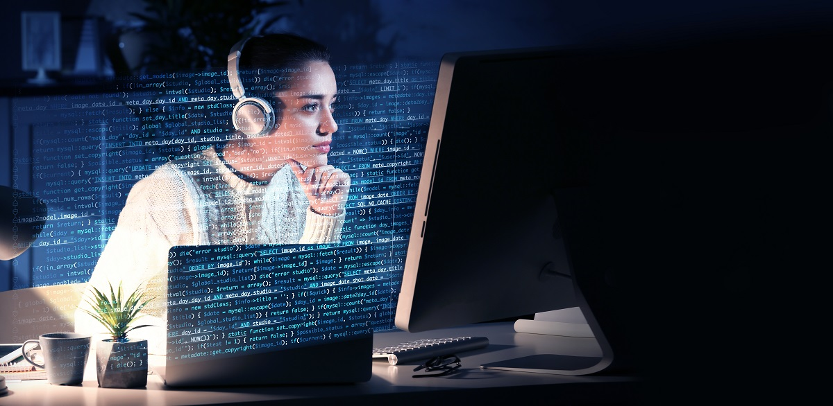 Young woman working with computer at table. Concept of cyber attack