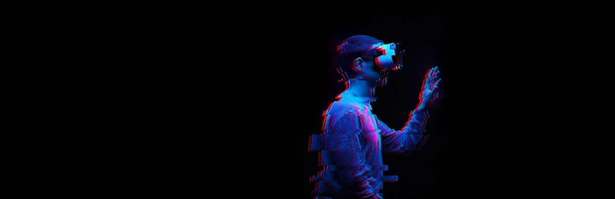 Man is using virtual reality headset. Image with glitch effect. Concept of virtual reality, simulation, gaming and future technology