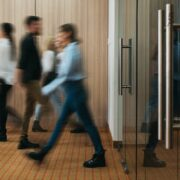 Group of business people walking at office openspace. Team of business employees at coworking center. People at motion blur. Concept working at action