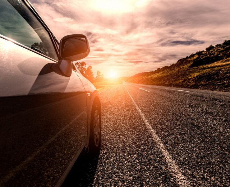 car-travelling-by-sunny-road