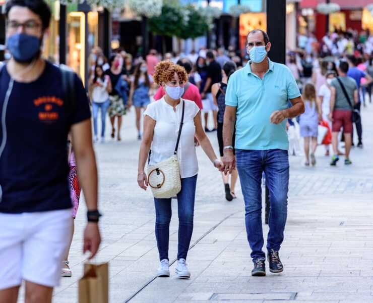 people-walk-comercial-street-named-meritxell-after-covid19