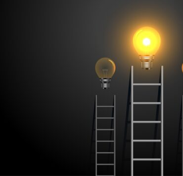 success concept ladder with glowing light bulb